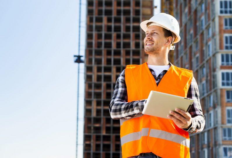 medium-shot-construction-engineer-using-tablet
