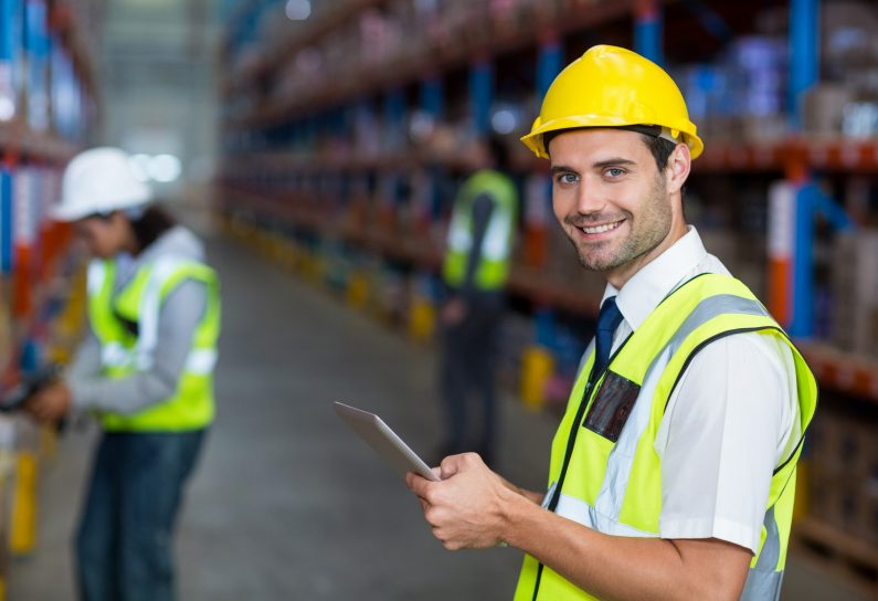 Portrait of warehouse manager holding digital tablet in warehouse