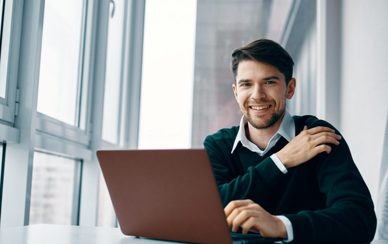 Business man working desk laptop smile communication internet