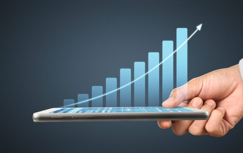 Plan graph growth and increase of chart positive indicators in his business,tablet in hand
